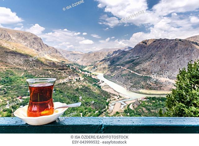 Landscape view of Kemaliye town between valley with Turkish tea on foreground in Kemaliye or Egin, Erzincan, Turkey