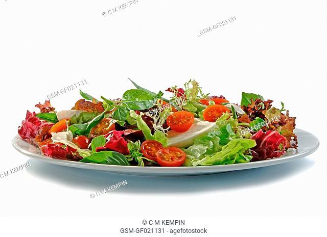 Lettuce, tomato, and basil salad