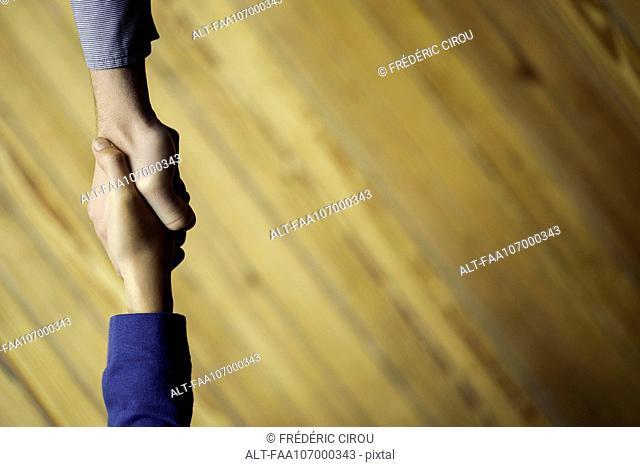 Greeting with handshake