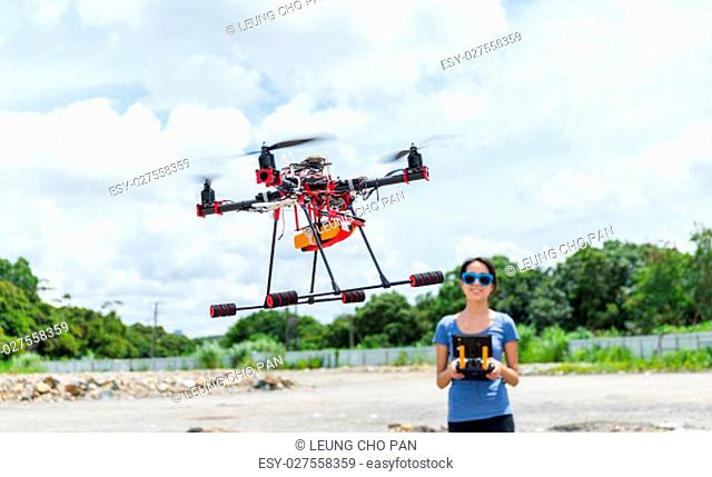 Woman play with flying drone