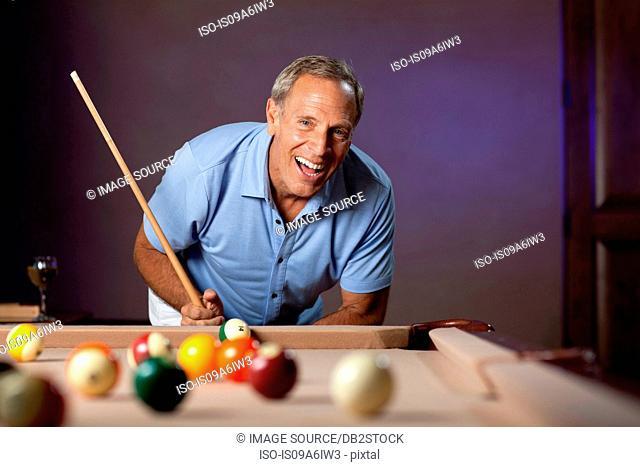 Older man playing pool