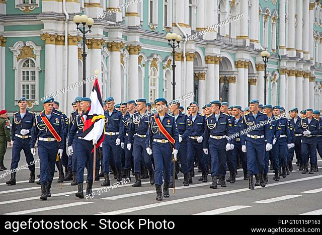 Military parade of Russian Airborne cadets wearing telnyashkas and blue berets marching in front of the Hermitage in Saint Petersburg, Russia