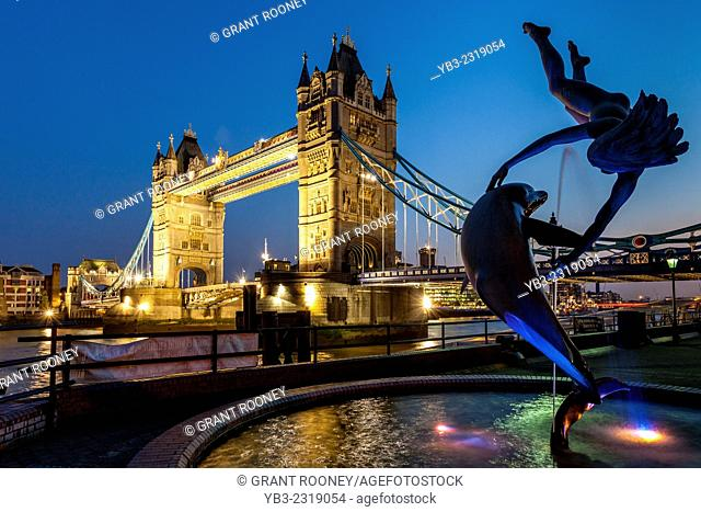 Girl With A Dolphin Fountain and Tower Bridge, London, England
