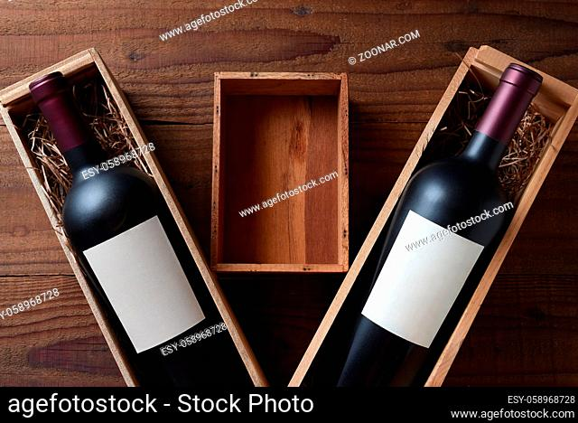 Wine Still Life: Two wood wine boxes with a bottle with blank labels. Between the boxes is a small empty box