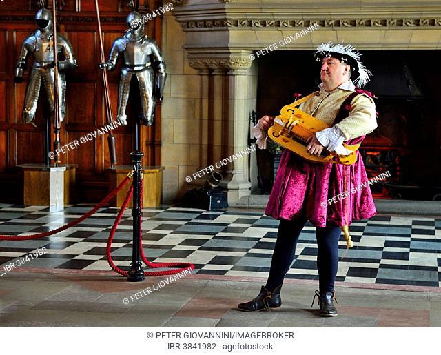 Musician in period costume performing on a medieval hurdy-gurdy, Edinburgh Castle, Edinburgh, Scotland, United Kingdom