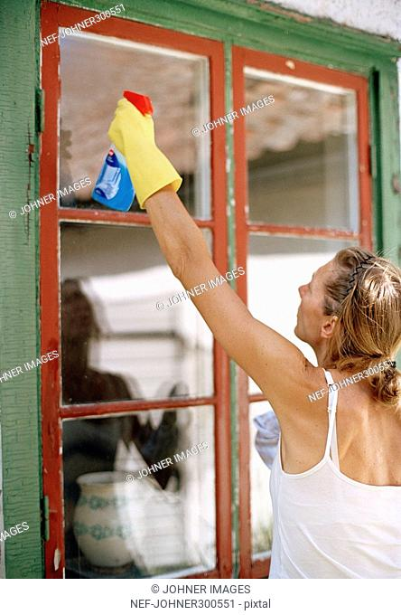 A woman cleaning windows
