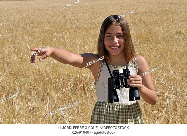girl with binoculars in the field