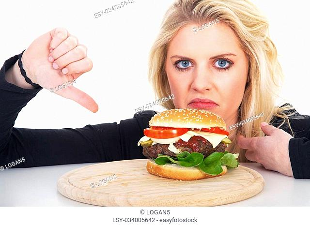 pretty woman finds hamburger and showing thumbs down