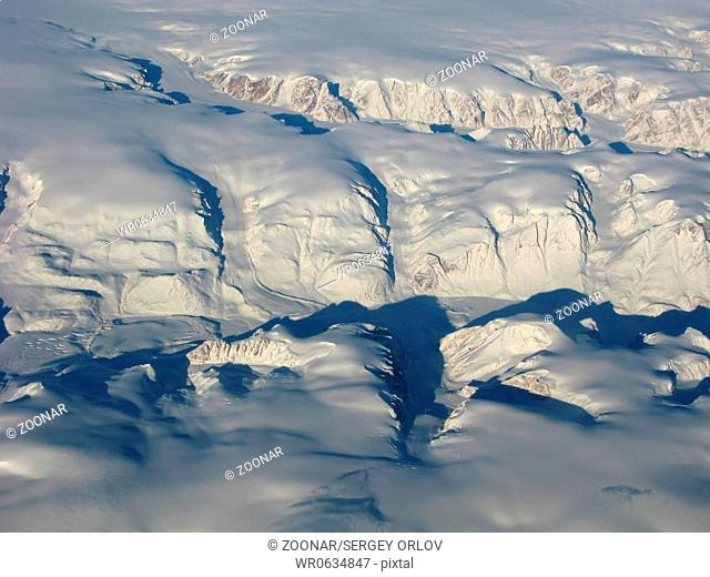 Aerial view of the Greenland glacier and mountains