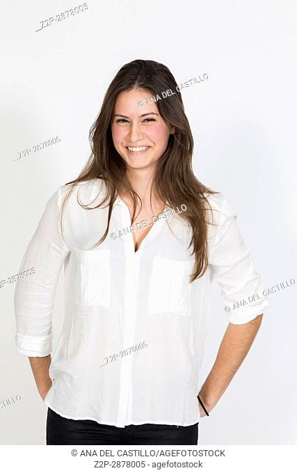 Studio portrait of young pretty woman on white background