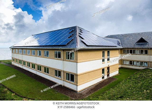 Solar panels installed in contravention of their own planning rules and guidelnes on the roof of the headquarters of Ceredigion County Council