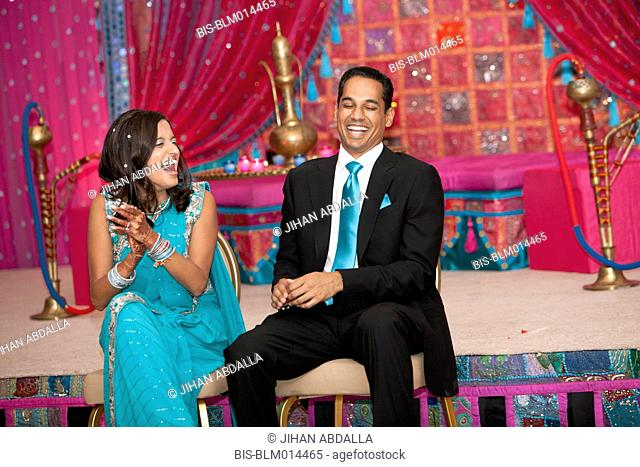 Laughing Indian couple at wedding