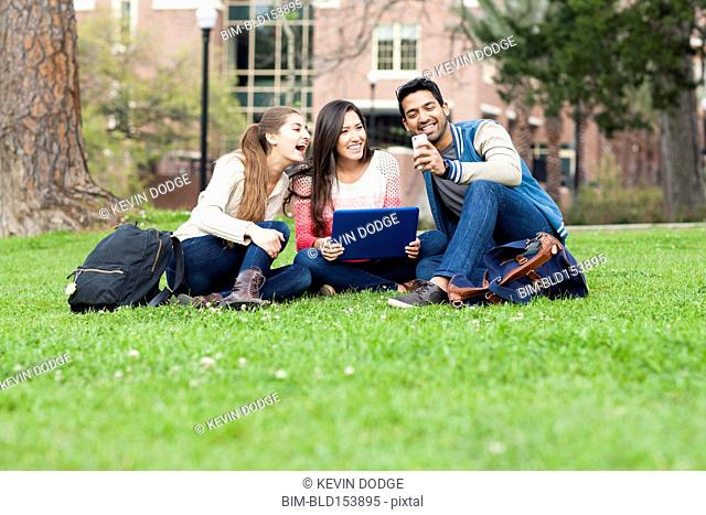 Students taking cell phone photograph on campus