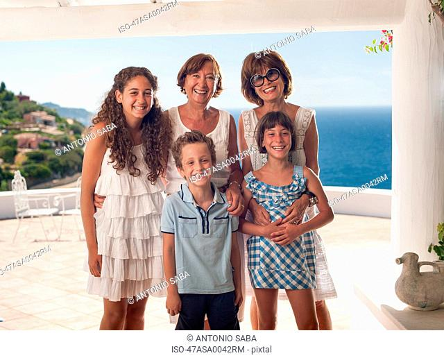 Family smiling together on balcony
