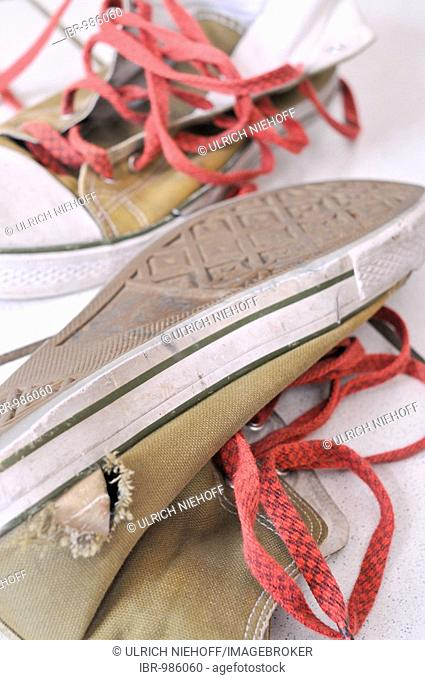 Old, torn cloth shoes