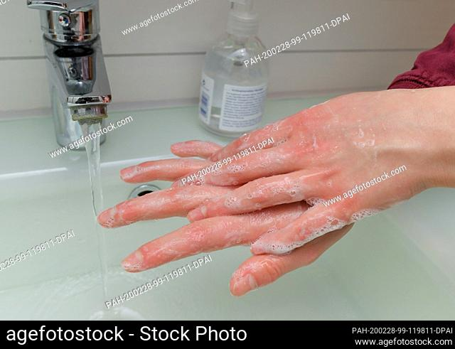 ILLUSTRATION - 27 February 2020, Brandenburg, Sieversdorf: A girl washes her hands with soap and water (posed photo). Hand hygiene measures are among the most...