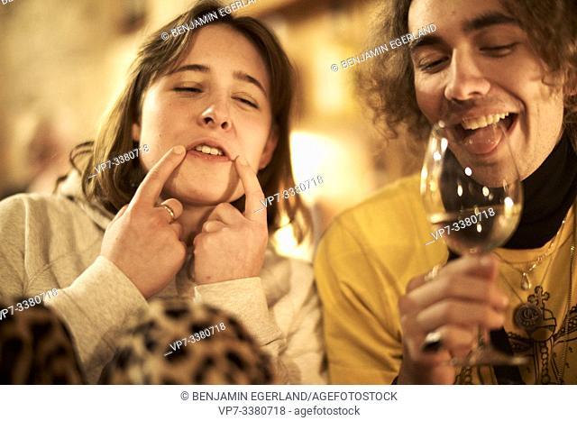 drunk friends in restaurant