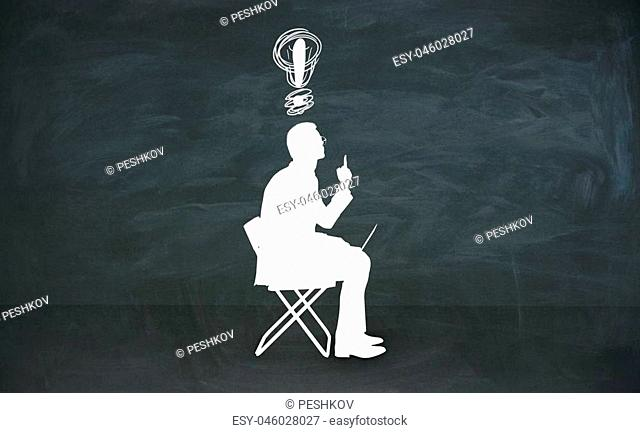 Abstract sitting man silhouette with lamp over head in chalkboard room. Idea concept. 3D Rendering