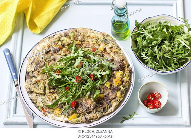 Frittata with mushrooms, red and yellow peppers, rocket and fresh chillies