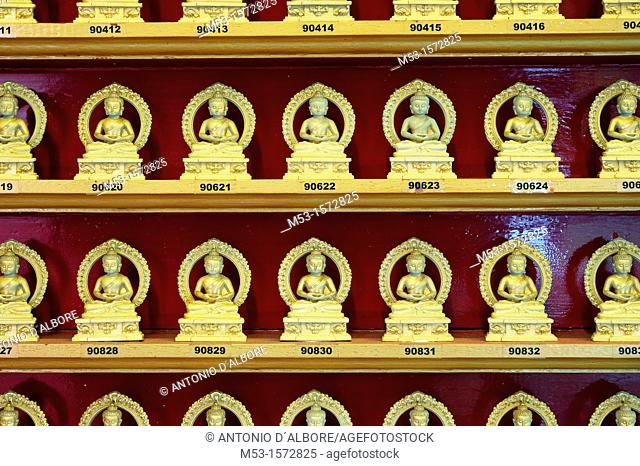 Numbered golden statues of Buddha while meditating in lotus position  Singapore Buddha Tooth Relic Temple and Museum