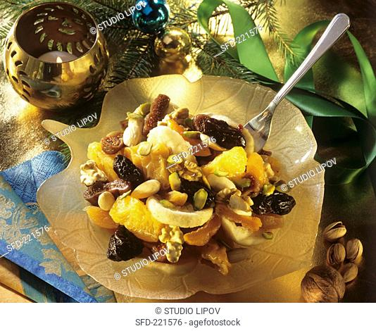 Christmassy fruit salad with nuts and dried fruit