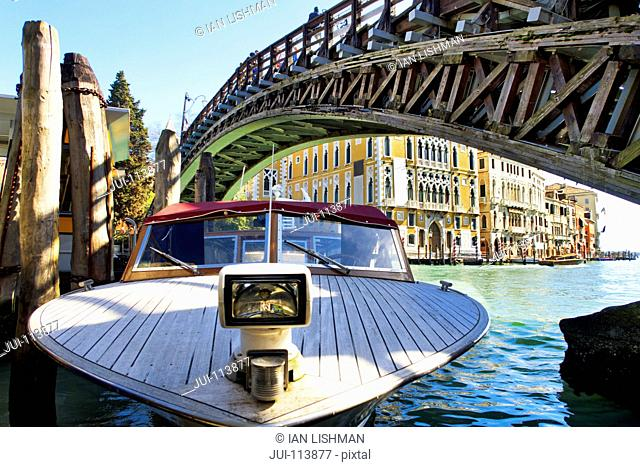 Boat moored in Grand Canal under bridge at Ponte dell'Accademia, Venice, Italy