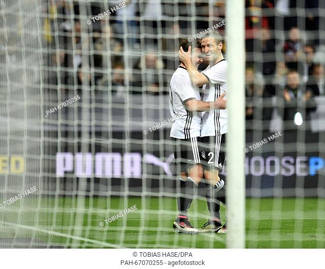 Germany's Mario Goetze (L) celebrates his 2-0 goal with Shkodran Mustafi during the international soccer match between Germany and Italy in the Allianz Arena...