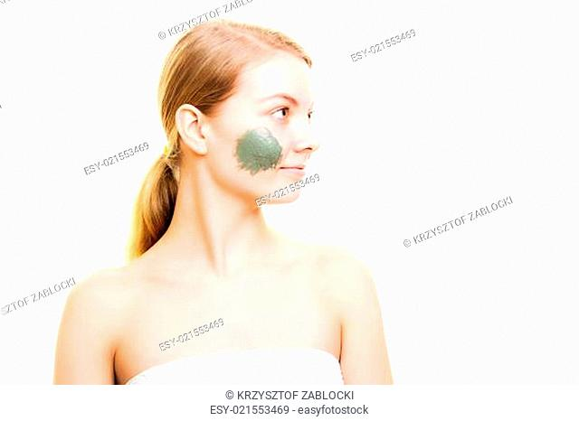 Skin care. Woman with clay mud mask on face