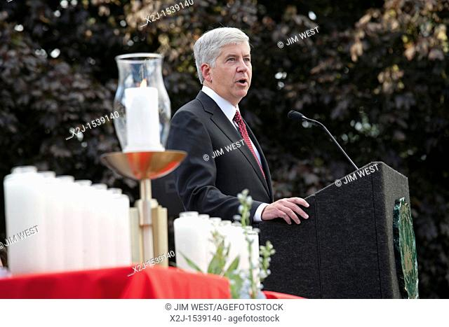 Dearborn, Michigan - Michigan Governor Rick Snyder speaks at an interfaith 'Remembrance and Unity Vigil' at The Henry Ford museum commemorating the tenth...