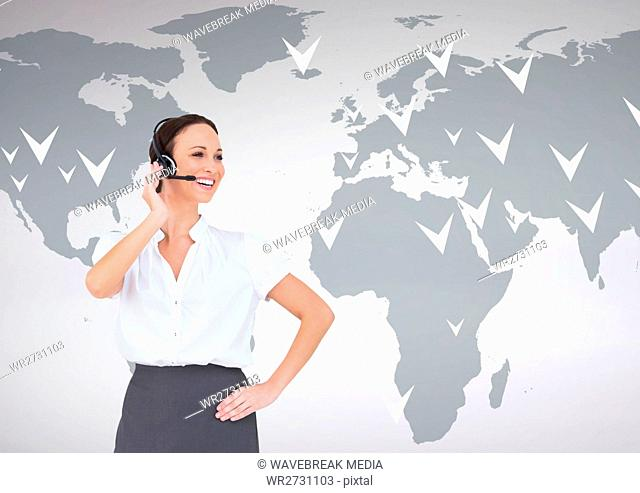 Businesswoman talking on headset with world map in background