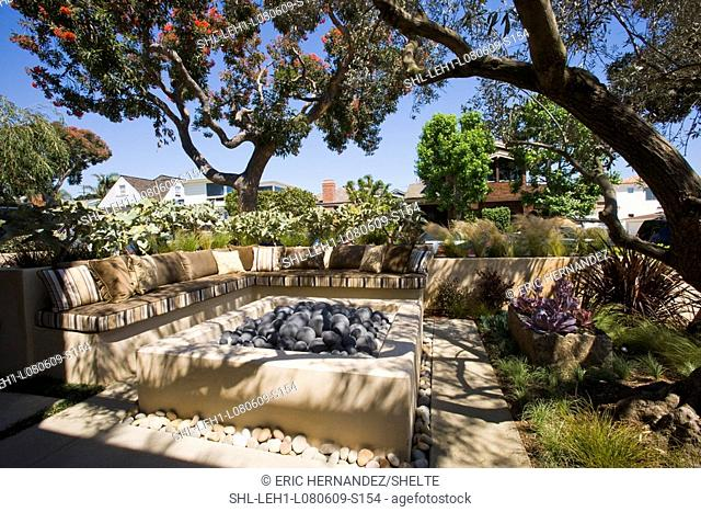 Outdoor sitting area with fire pit and sofa