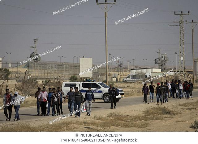 African asylum seekers, who were released earlier today, walk out of Saharonim Prison, in the Negev desert, Israel, 15 April 2018