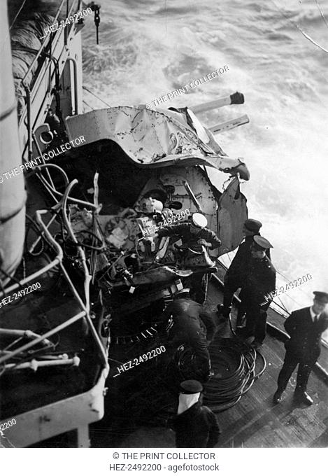 Damaged anti-aircraft gun on the British battleship HMS 'Malaya', off the coast of Portugal, 1937. The damage occurred in a collision with the Dutch steamer...