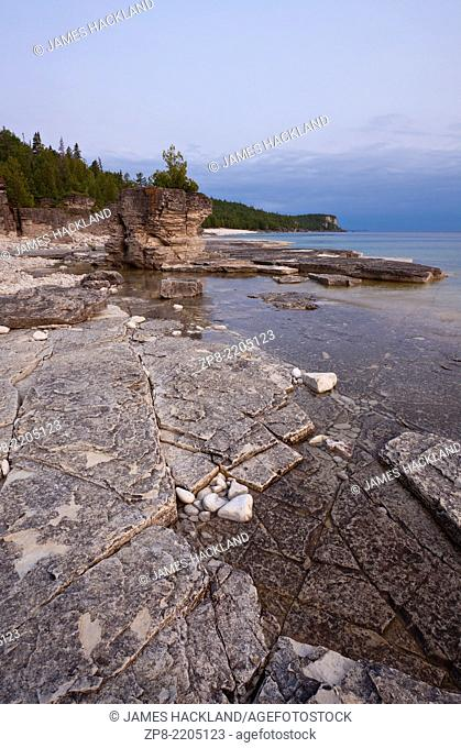 Interesting rock formations with an incoming storm in the distance. Bruce Peninsula National Park, Ontario, Canada