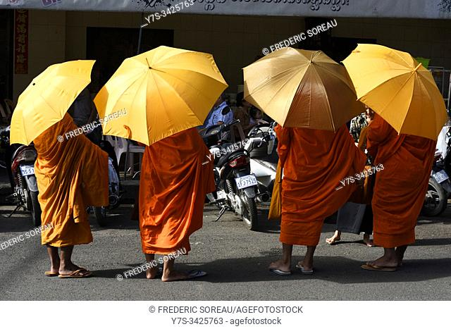 Buddhist monks on their morning alms round,Phnom Penh,Cambodia,South Esat Asia