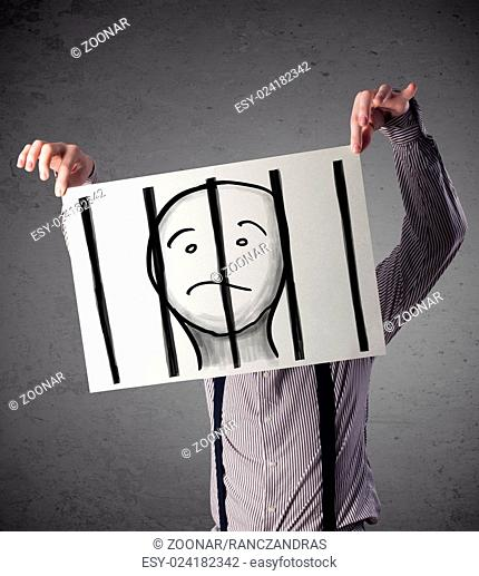 Businessman holding a paper with a prisoner behind the bars on it in front of his head