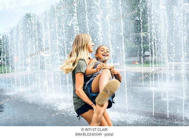 Sisters playing near fountain