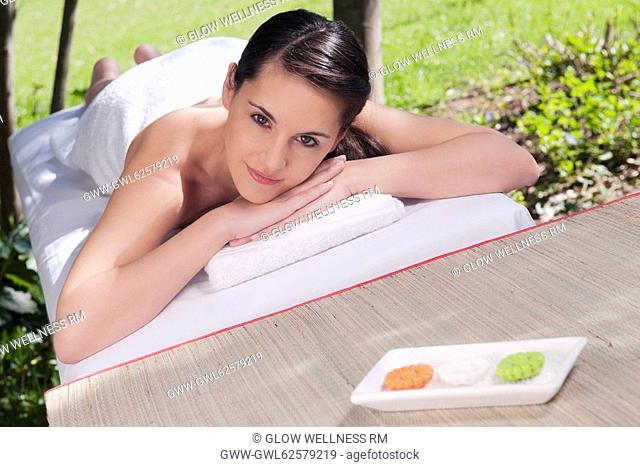 Woman lying on a massage table