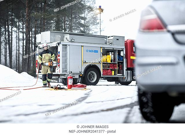 Firefighter on road