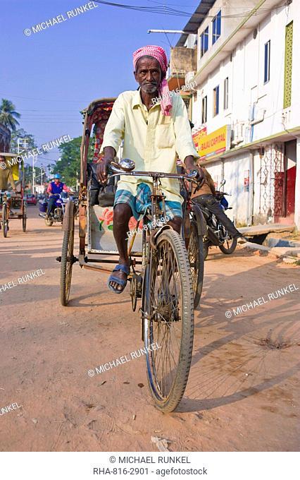 Rickshaw driver on his bicycle, Agartala, Tripura, Northeast India, Asia