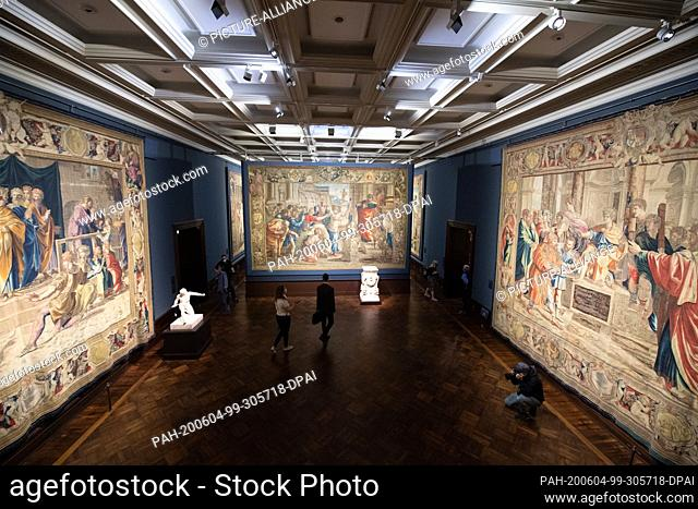 """04 June 2020, Saxony, Dresden: Participants of a press tour will stand in the exhibition """"""""Raphael - Power of Images. The Tapestries and their Effect"""""""" in front..."""
