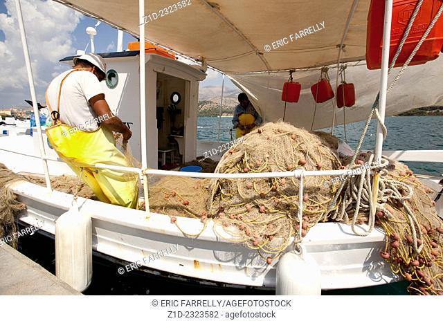 Fishermen mending nets at Cephalonia Greek Islands
