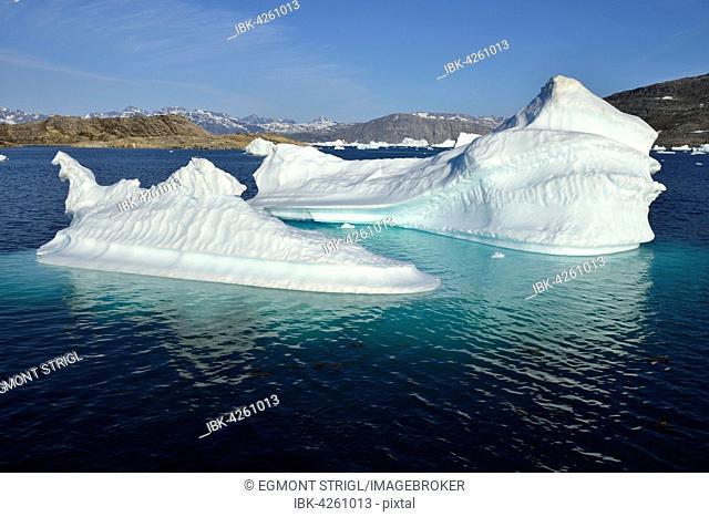 Iceberg drifting in Tasiilaartik Fjord, Kalaallit Nunaat, East Greenland, Greenland