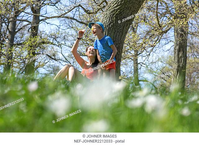 Mother with son in spring woods