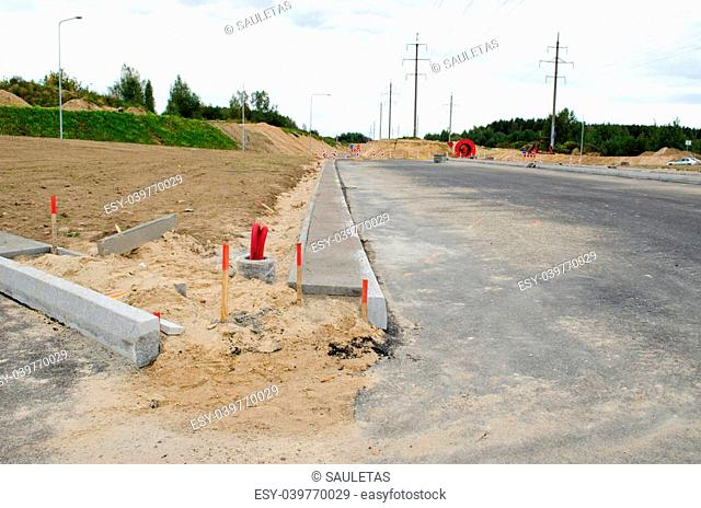 building new road construction cars go roundabout and lighting pole wires lay
