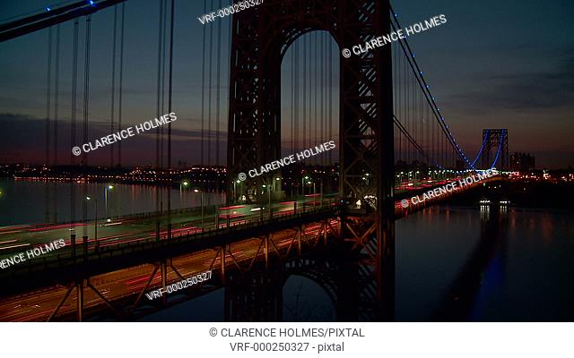 Timelapse sequence of morning rush hour traffic on the George Washington Bridge crossing the Hudson River between New Jersey and New York just before sunrise