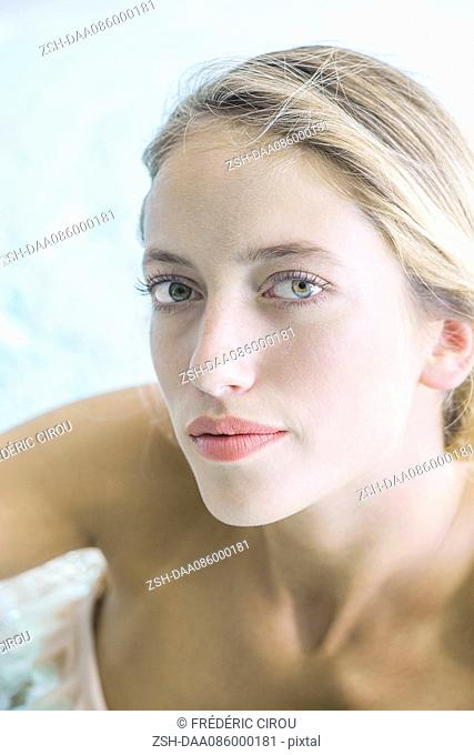 Woman soaking in spa, portrait