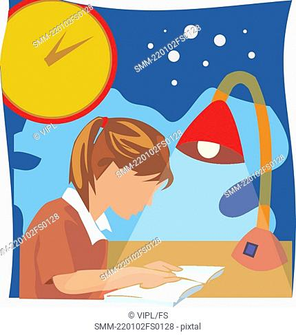 Side view of a girl studying book