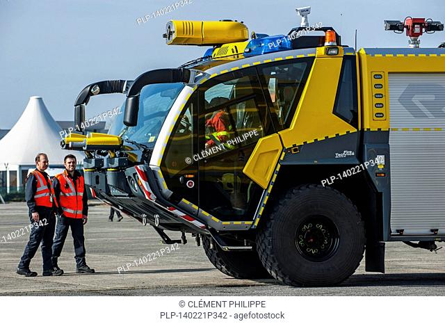 Firefighters and airport crash tender Rosenbauer Panther CA-5 6×6 at the Ostend aerodrome, Belgium
