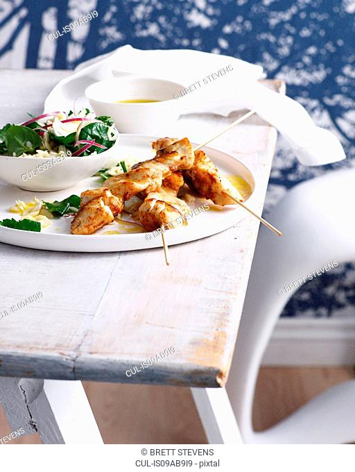 Spiced fish with orzo and spinach